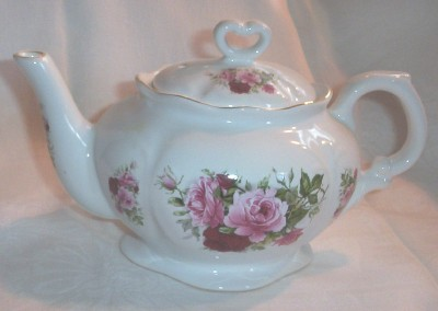 Rose covered teapot